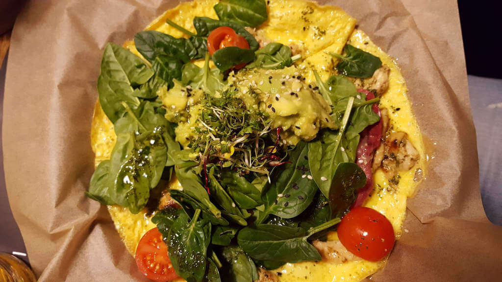 Omlette with herbs, spinach and cherry tomatos