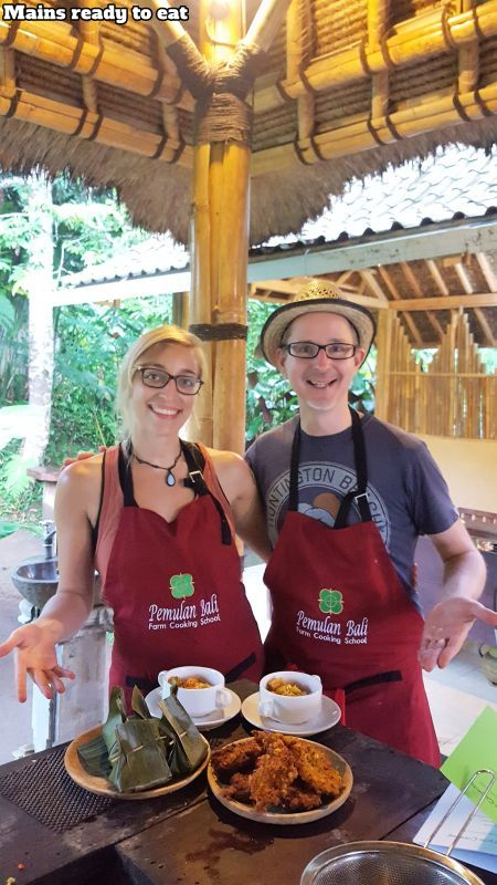 Bali Farm Cooking School. Main courses. Aurelie and I are presenting the finished dishes. Curry, Corn Fritter and Pepes.