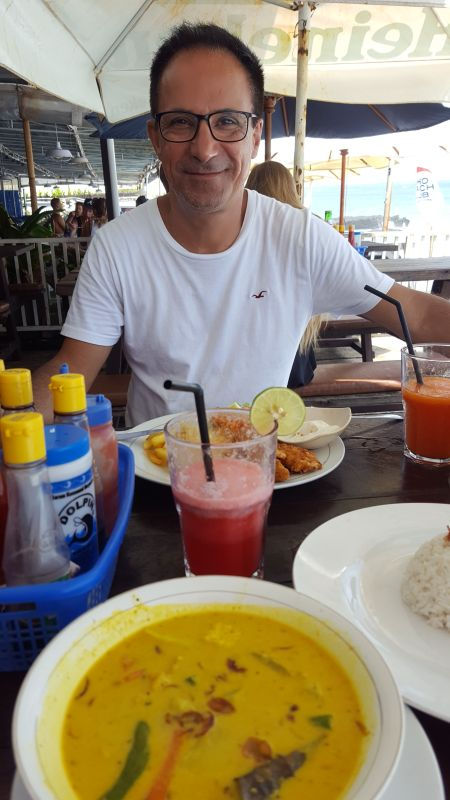 Dian Cafe Canggu. Lunch. Vegetable curry, Watermelon juice, fish and chips, papaya juice and salt and pepper and other spices.