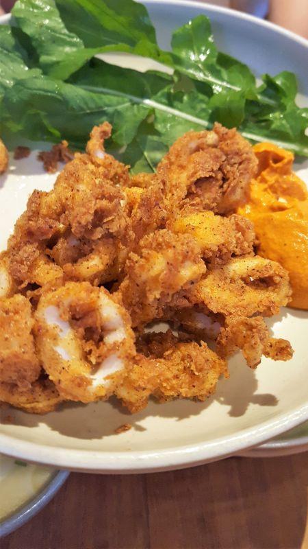 Mason Canggu. Calamari with salad garnish and a spicy sauce.
