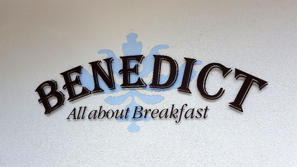 """Benedict wall sign saying """"Benedict - All about Breakfast"""""""