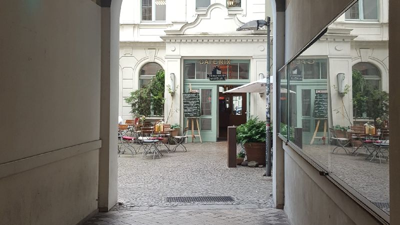 Café Rix. Gate passage and view into the courtyard.